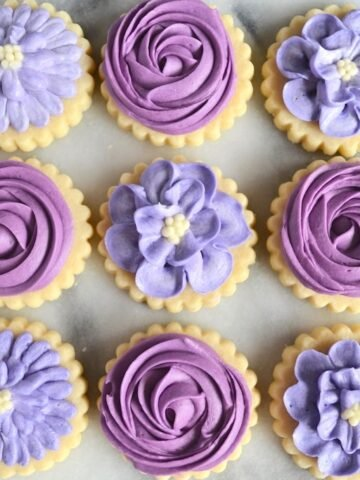 Purple buttercream frosted sugar cookies