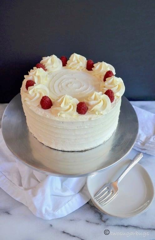 raspberry cake on a cake stand
