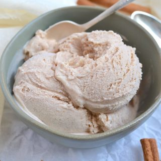 Cinnamon ice cream in a bowl with a spoon