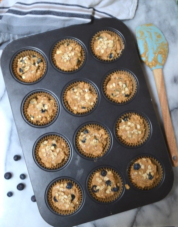 Hearty whole wheat blueberry oat muffins. Perfect for breakfast! #twosugarbugs #blueberryoatmuffin #muffin #breakfastisserved