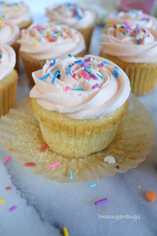 Simply Vanilla Cupcakes. Made with melted butter and a whisk, easy enough for everyday. Soft and fluffy with the perfect amount of vanilla. #twosugarbugs #vanillacupcakes #easycupcakes #cupcakes