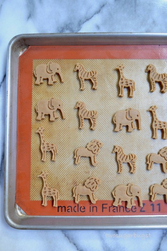 unbaked animal crackers on a silicone baking mat