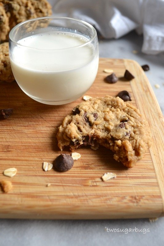 cookie with a bite missing and a cup of milk