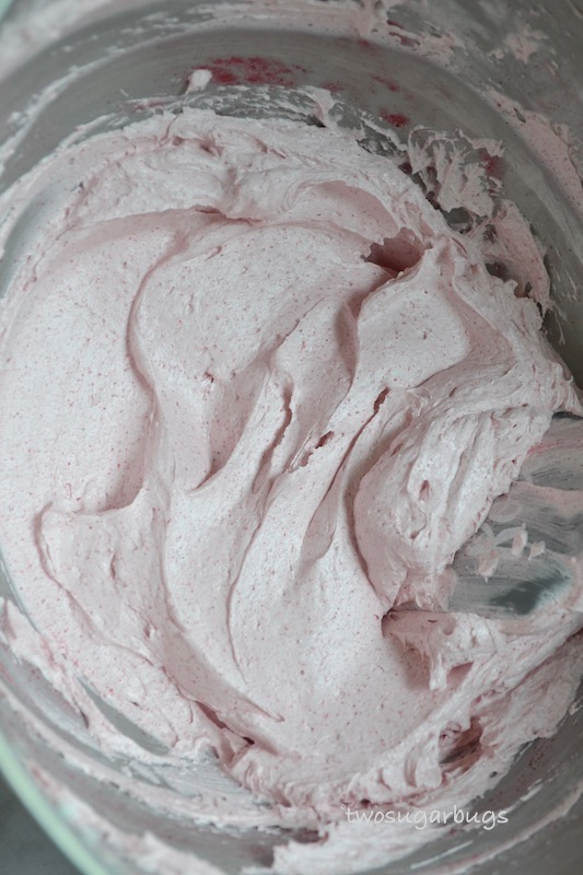 berry swiss meringue buttercream in a mixing bowl