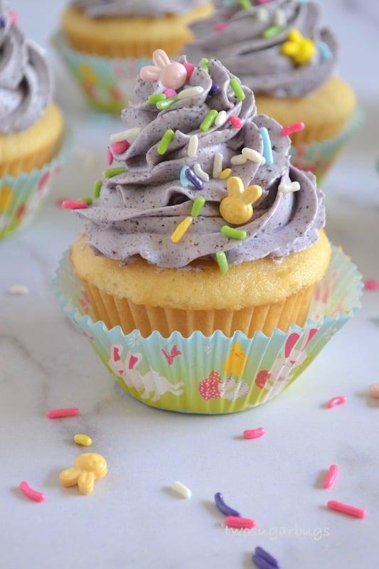 photo of a lemon cupcake with sprinkles