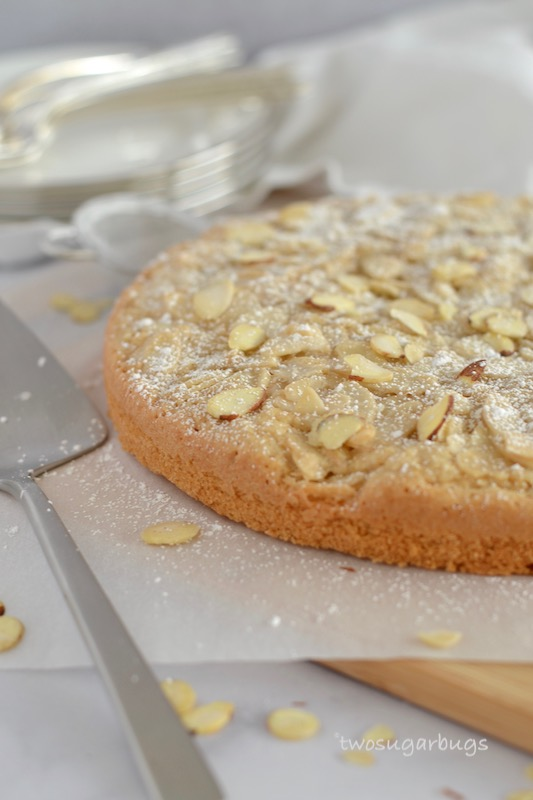 almond cake on parchment and a cutting board