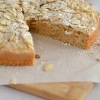 Crumbly almond cake with a slice missing
