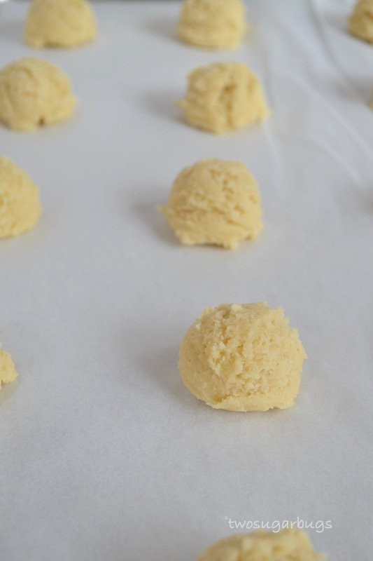 Cookie dough on parchment lined baking sheet