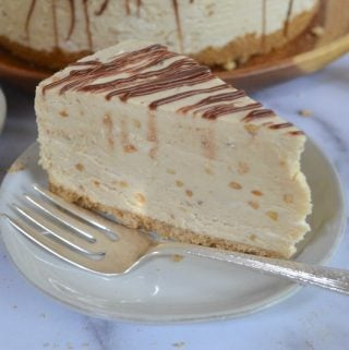 Slice of peanut butter pie on a plate with a fork