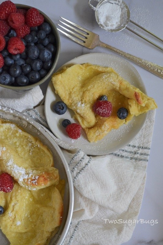 slice of Dutch Baby on a plate