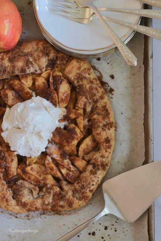 baked cinnamon apple crostata with ice cream scoop on top