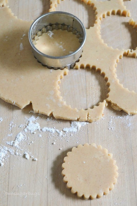 rolled out dough with cookies and cookie cutter