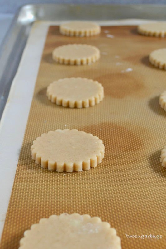 Cinnamon cut-out cookie dough on silicone baking mat