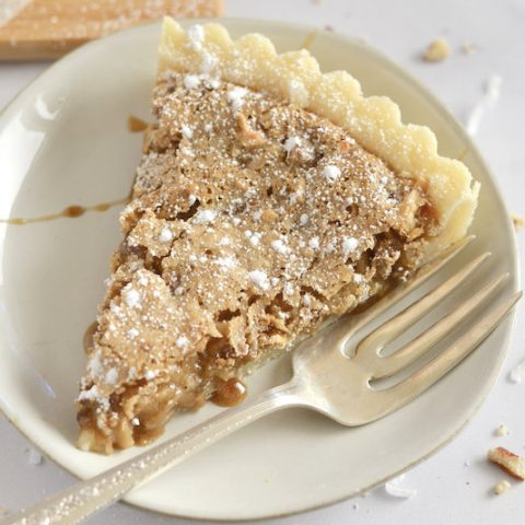 Slice of tart on a plate with a fork.