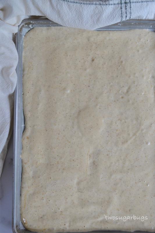 Cookie butter Swiss roll batter on baking sheet pan.