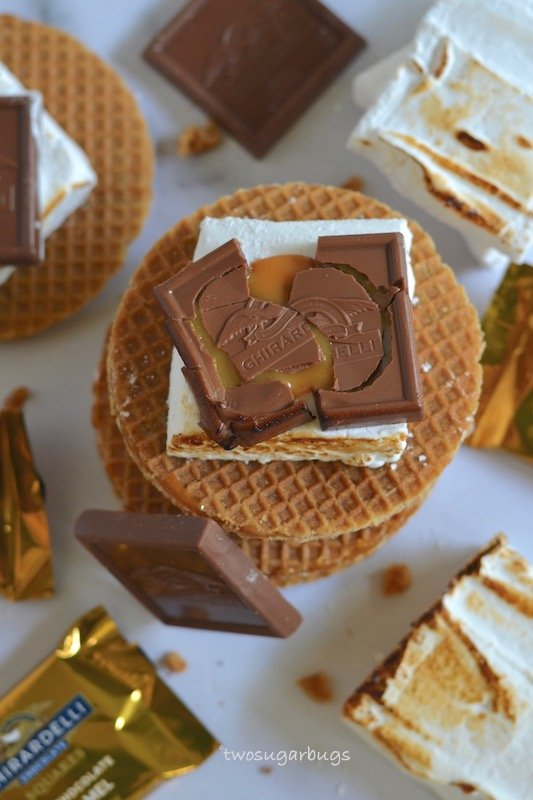 Overhead shot of s'mores made with homemade marshmallows, stroopwaffles and Ghiradelli caramel chocolates.