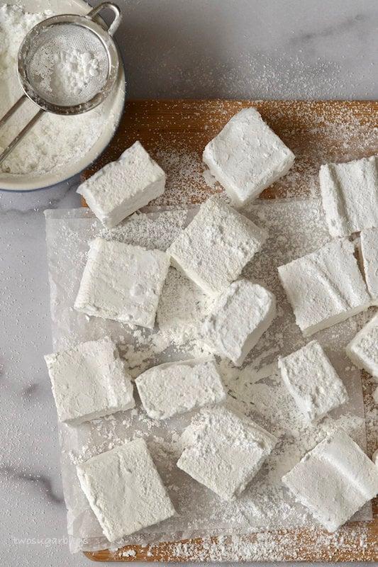 Overhead shot of homemade marshmallows on a cutting board.