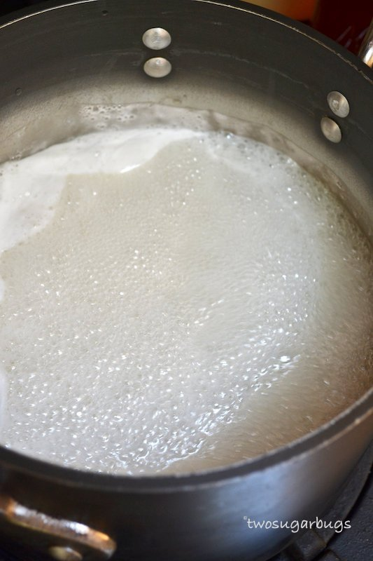 Sugar, water and gelatin mixture at a low boil in saucepan.