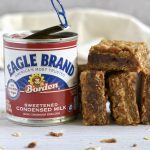 Pumpkin caramel spice bars lined up next to Eagle Brand can.