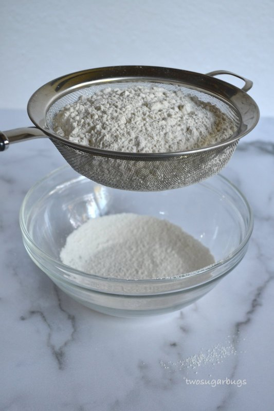 Flour being sifted into a bowl