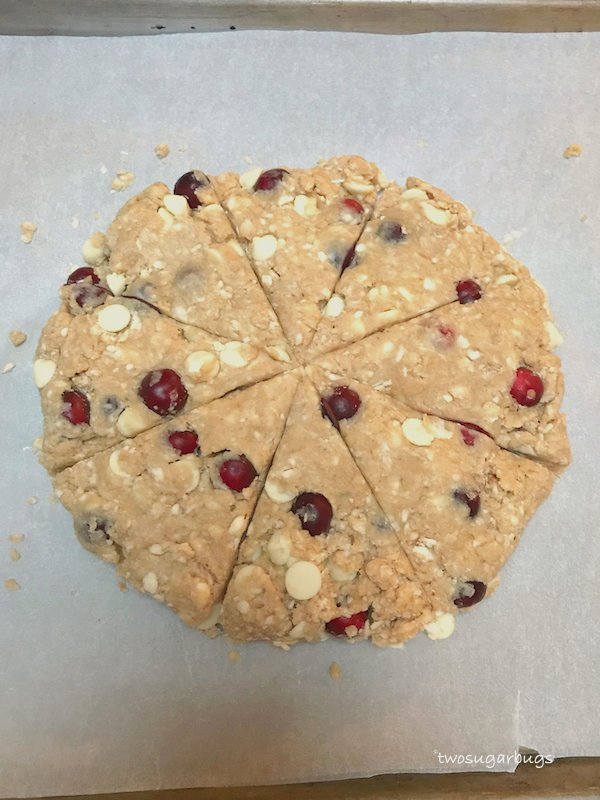 "Unbaked cranberry white chocolate scones in 8"" circle and cut into 8 wedges"