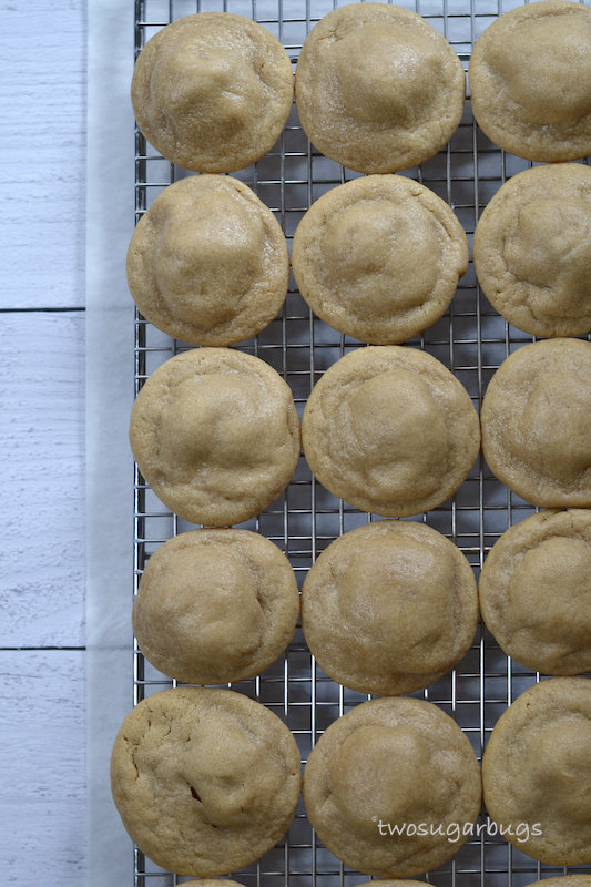 peanut butter snickers cookies on a wire cooling rack