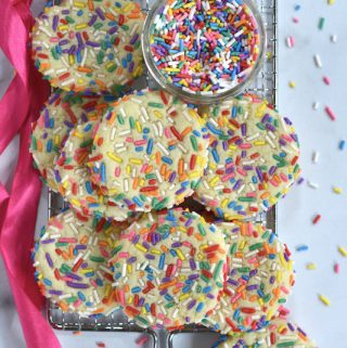 cookies and sprinkles on a cooling rack
