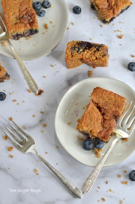 blueberry coffee cake on plates with forks