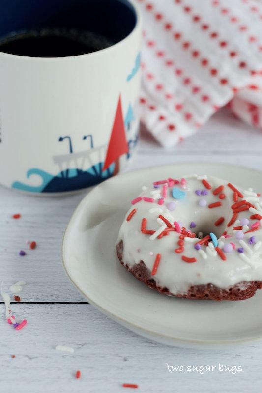 donut on a plate with a coffee mug