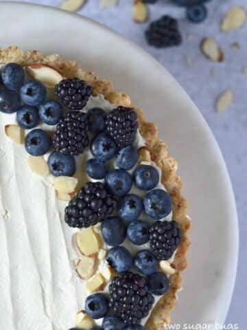 close up of almond and berry mascarpone tart