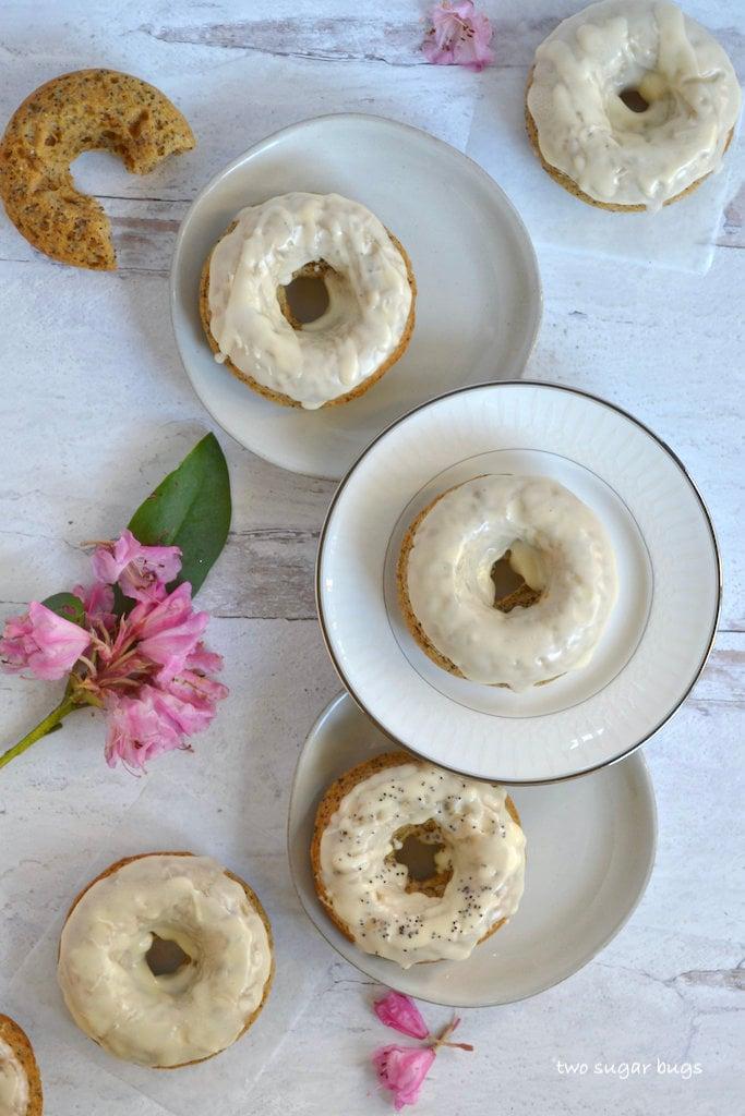 orange poppyseed donuts with glaze on plates