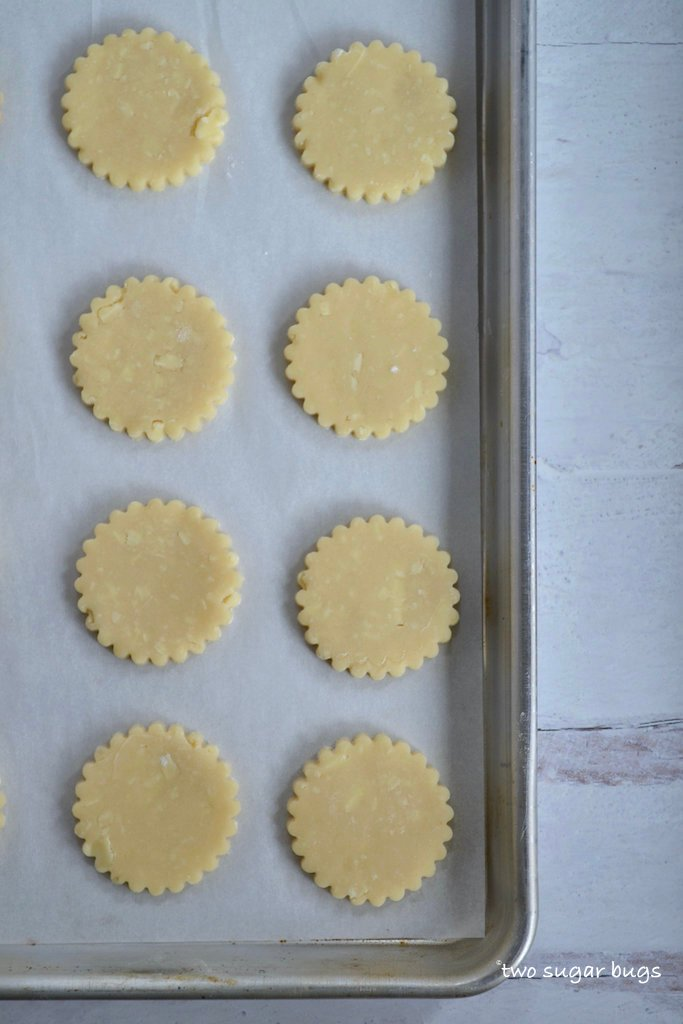 unbaked cookies on a parchment lined cookie sheet