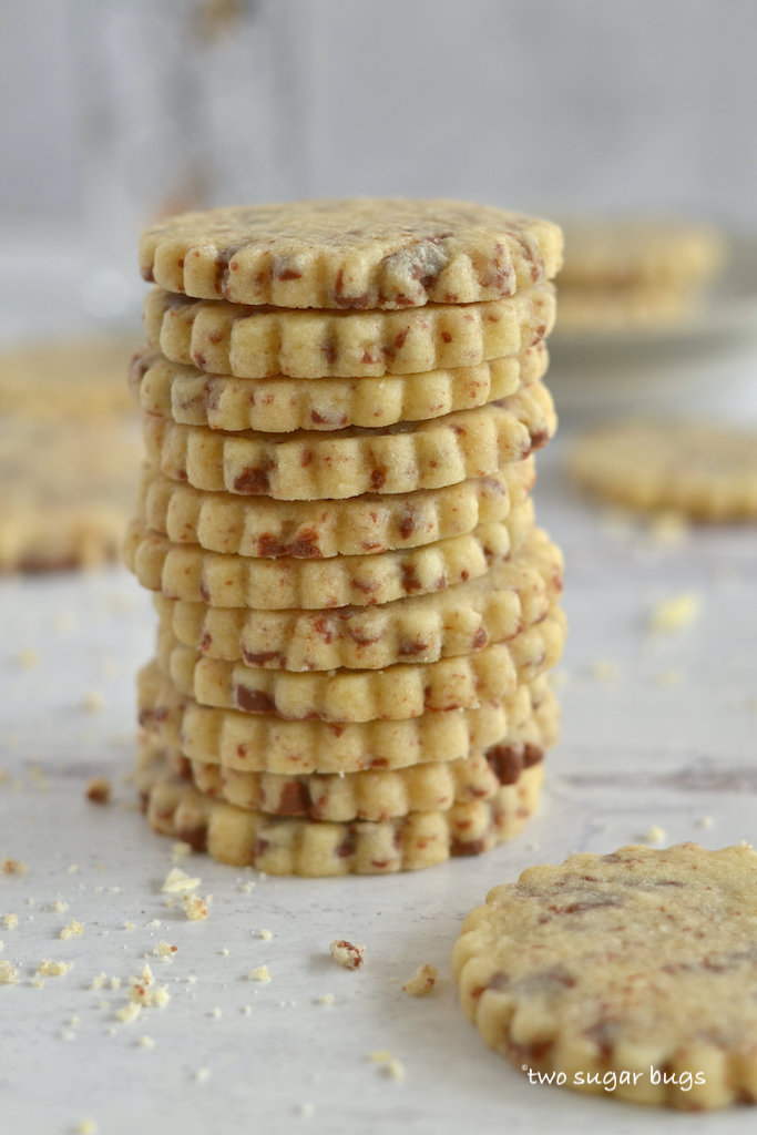 a stack of sugar cookies made with milk chocolate
