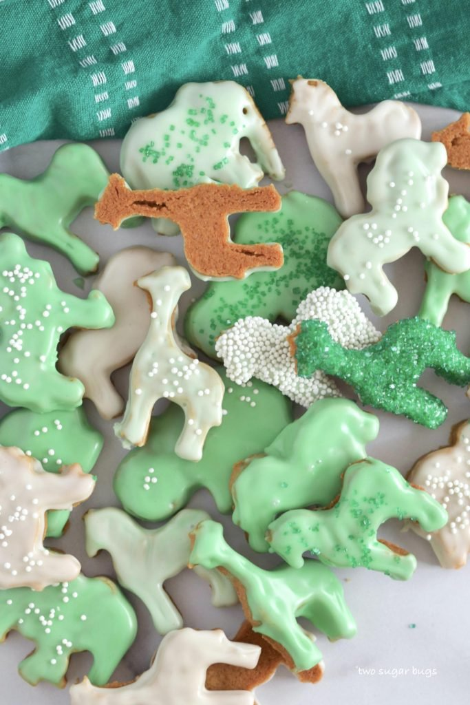 animal crackers glazed with green and white frosting and sprinkles