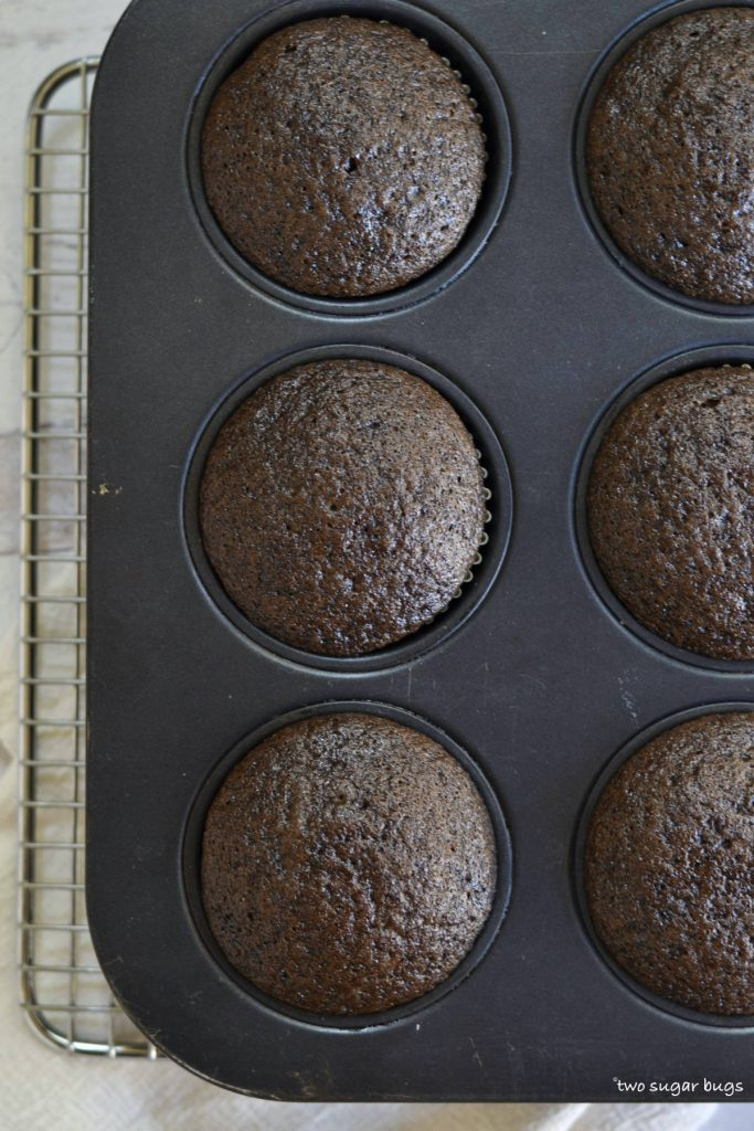 baked chocolate cupcakes in a muffin pan