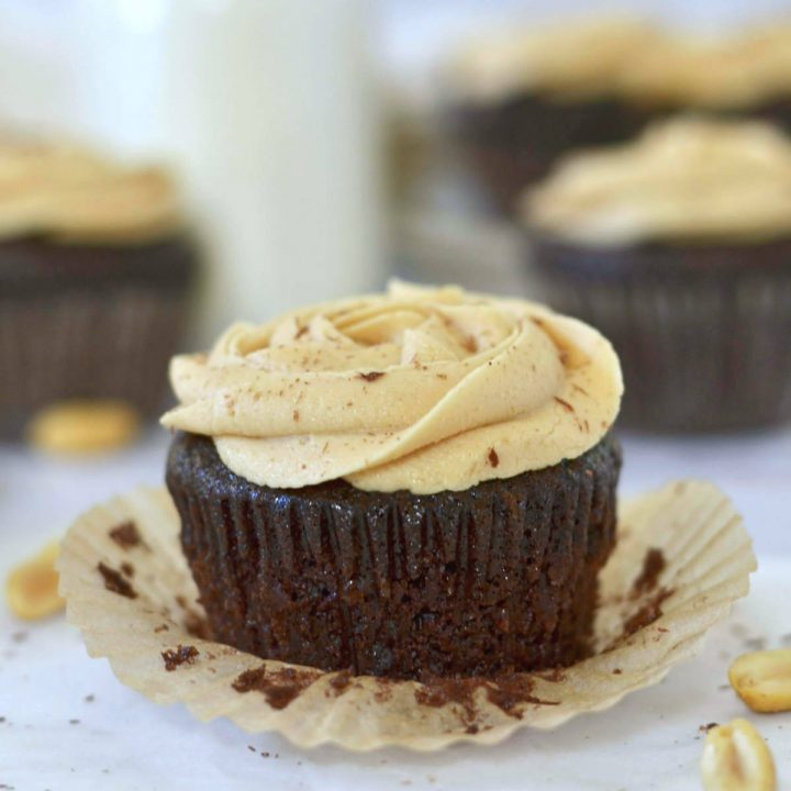 up close photo of chocolate peanut butter cupcake with the liner off