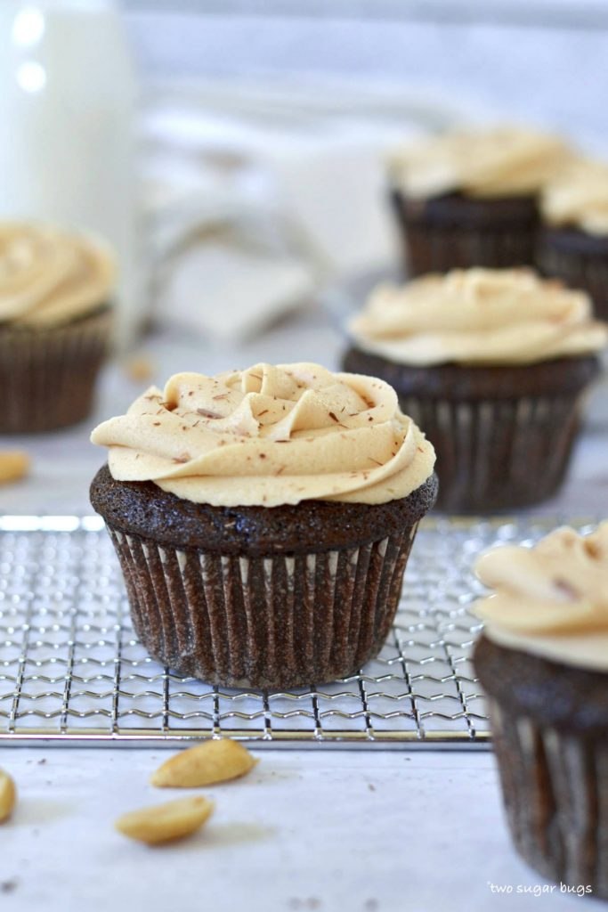 chocolate peanut butter cupcake on a cooling rack