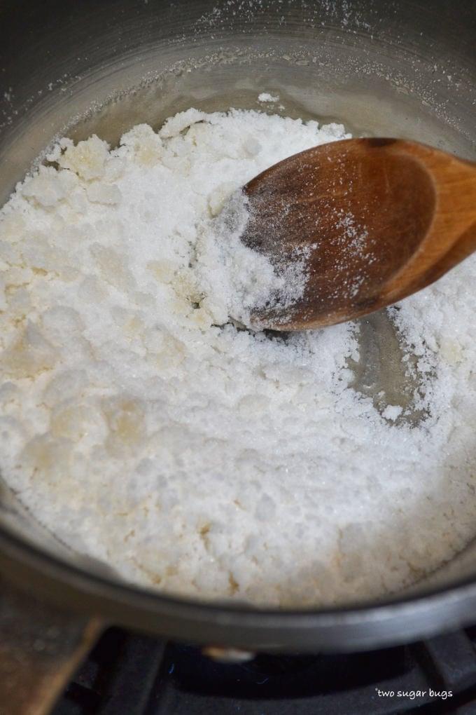 sugar starting to melt in a saucepan
