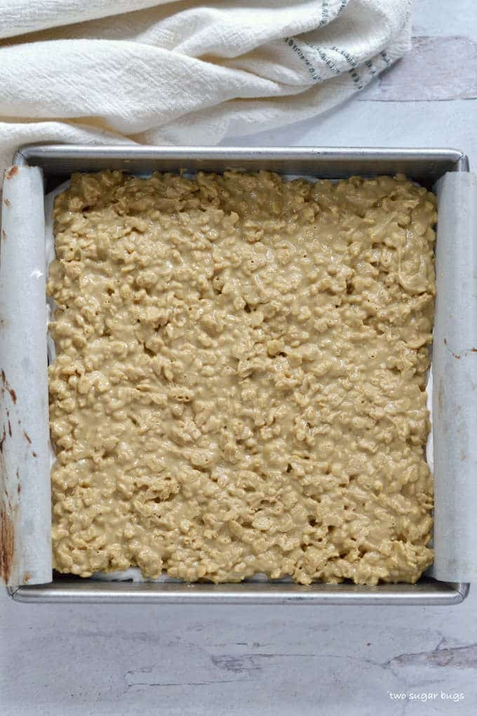 SunButter, white chocolate and crispy rice layer in baking pan