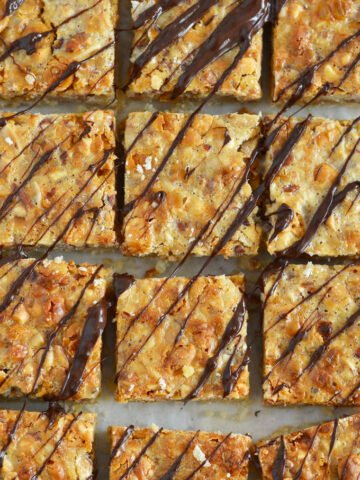close up of nut bars with chocolate drizzled over the tops.