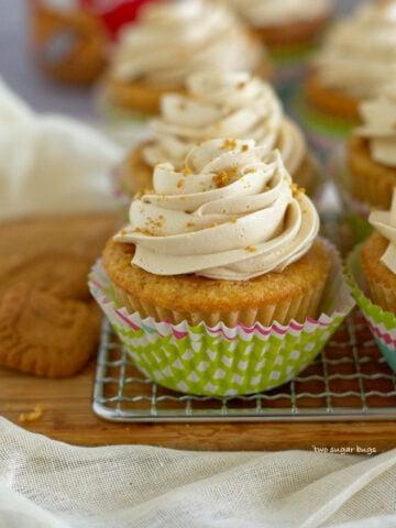 decorated biscoff cookie butter cupcake in a bright cupcake wrapper