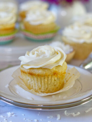 vanilla rum coconut cupcake with the wrapper pulled off