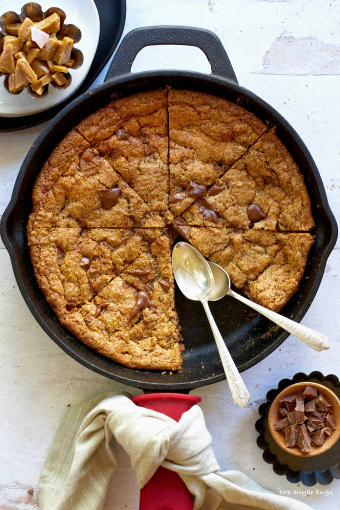 almond flour skillet cookie with a piece missing