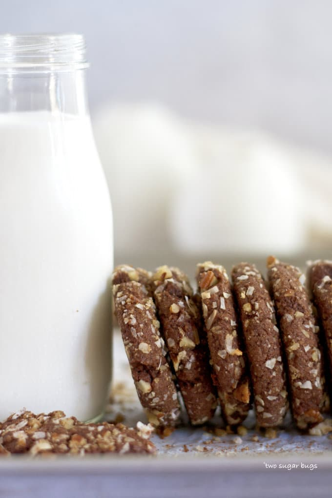 cookies and milk lined up on a baking pan