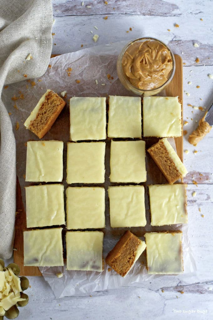 overhead shot of peanut butter white chocolate blondies with a jar of peanut butter