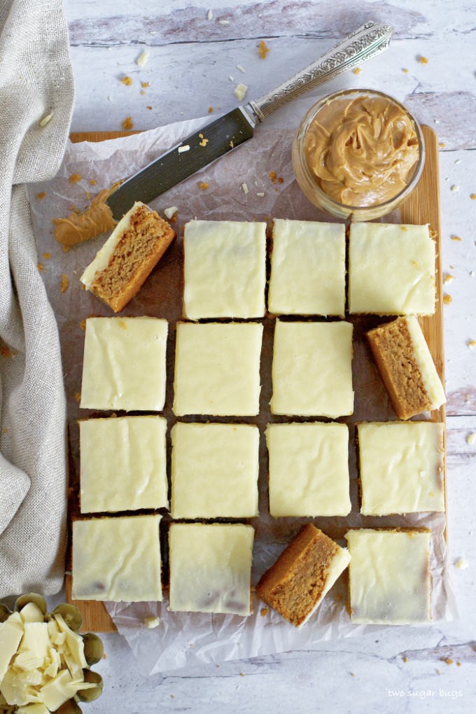 peanut butter blondies on a parchment lined cutting board