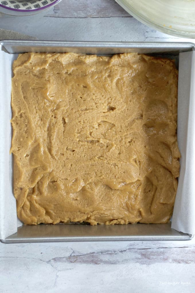 peanut butter batter in the baking pan
