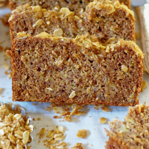 a slice of healthy apple cider banana bread