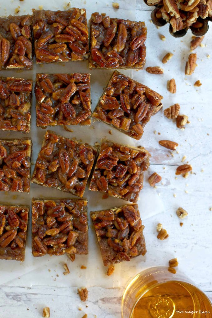 cut banana pecan bars on a sheet of parchment paper