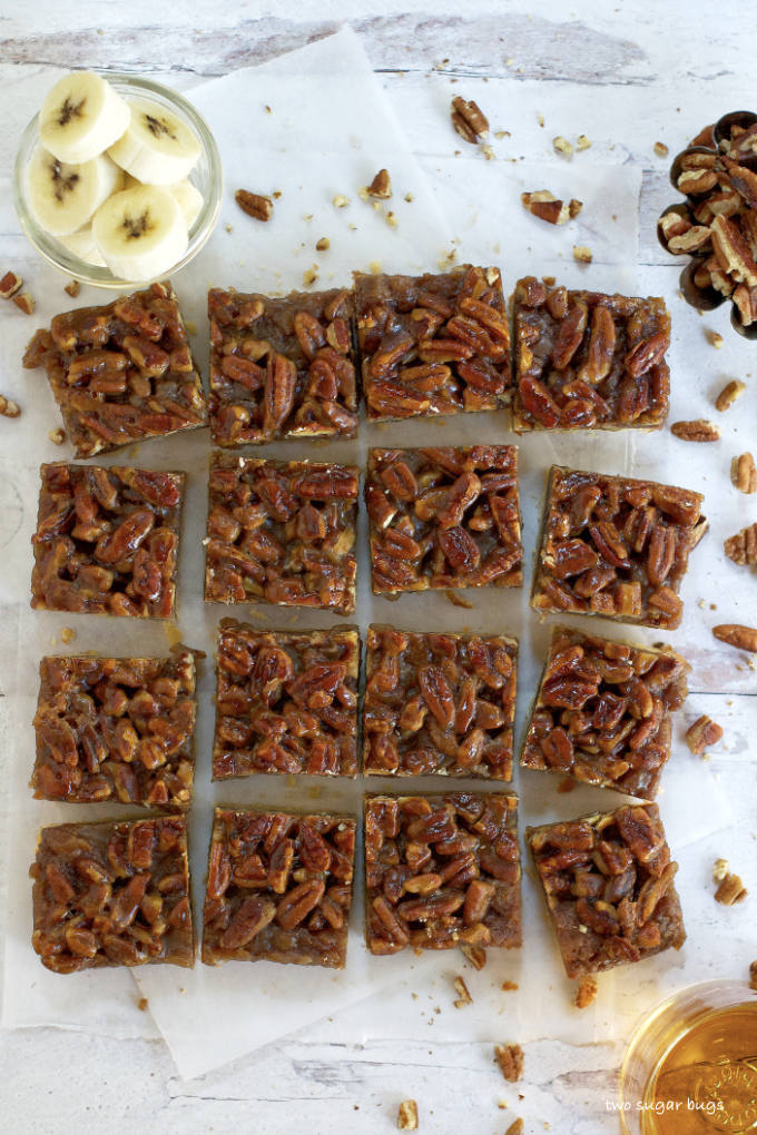 overhead view of cut bars with bananas and pecans